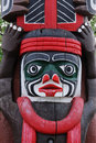 Carving face on a totem pole Stock Photos