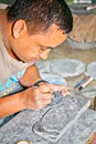 Carving mani stones in kathmandu nepal as devotional or intentional process art is a traditional sadhana of Stock Photo