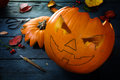 Carving a pumpkin for halloween, tinker autumn decoration on a b Royalty Free Stock Photo