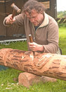 Carving a totem pole. Royalty Free Stock Photo