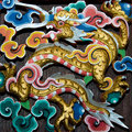 Carving wood of dragon in joss house Stock Photo