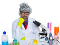 Carzy pensive nerd scientist at chemical laboratory Royalty Free Stock Image