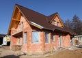 Casa del ladrillo que es construida Imágenes de archivo libres de regalías