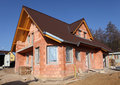 Casa del mattone che è costruita Immagini Stock Libere da Diritti