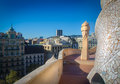 Casa mila statue gaudi chimneys at also called la pedrera city of barcelona in the background Royalty Free Stock Photography