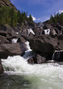 Cascade falls over river with rocks Royalty Free Stock Photo