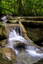 Cascade falls in tropical rain forest Stock Photos
