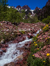 Cascade flowing from mountains a springtime the high mountain peaks in the maroon bells wilderness near vail colorado Royalty Free Stock Photography