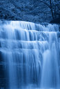 Cascade in the night soft water of waterfall Stock Image