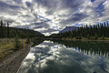 Cascade ponds reflections reflective and picturesque just outside of banff in banff national park canadian rockies alberta canada Royalty Free Stock Images