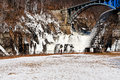 Cascade on river dam in winter panoramic view of waterfall Royalty Free Stock Image