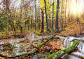 Cascade river in a forest mountain autumn Stock Photos
