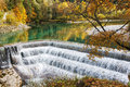 Cascade waterfall in a colorful autumn forest Royalty Free Stock Photo