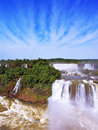The cascades of water roar of jungle grand iguazu falls on brazilian side multi tiered lush over boiling swirls fine Stock Photo