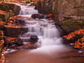 Cascading water over rocks in the autumn Royalty Free Stock Photo