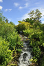 Cascading waterfalls view showing on a hot summer s day edinburgh botanic gardens Stock Images