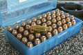 Case of fifty shiny bullets Royalty Free Stock Photo