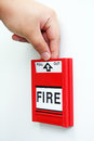 In case of fire close up image a hand pulling a alarm Stock Photos
