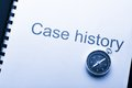 Case history and compass Royalty Free Stock Photo