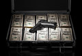 Case with money and gun silver on black background Royalty Free Stock Photo