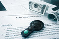 Cash and auto insurance policy Royalty Free Stock Photo