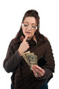 Cash or credit middle aged woman carefully trying to decide between using old fashioned a plastic gift card Stock Photo