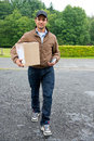 Cash on delivery guy bringing a parcel with online purchases to the door with a wireless machine in his hand Royalty Free Stock Image