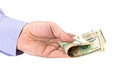 Cash in hand of businessman over white Royalty Free Stock Photography