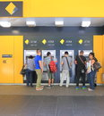 Cash machine queue people use commonwealth bank atm Stock Photo
