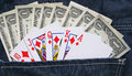 Cash and playing in denim jeans pocket american cards Royalty Free Stock Image