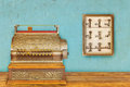 Cash register and cabinet with hotel keys and room numbers Royalty Free Stock Photo