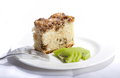 Cashew nut and coffe cake a slice on white plate dressed with kiwi fruit a for rest on the plate Stock Image