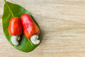 Cashew nut and leaf on wood Royalty Free Stock Photo