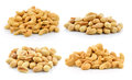 Cashew nuts heap and peanuts on white background Royalty Free Stock Photo