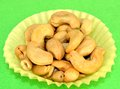 Cashews shelled in a yellow paper cup Royalty Free Stock Image