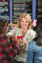 Cashier Serving Drinks Royalty Free Stock Photo