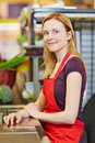 Cashier sitting at supermarket young smiling checkout Stock Photo