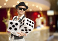 Casino blonde woman in a hat playing dice Stock Photos