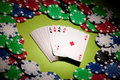 Casino cards and chips closeup in pointed light Royalty Free Stock Image