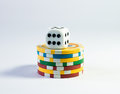 Casino chips and dice seven a white Royalty Free Stock Photo