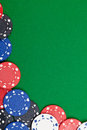 Casino chips different on green table background with copyspace Stock Photo