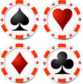 Casino chips with heats spades clubs and diamonds Stock Photos
