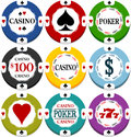 Casino chips with heats spades clubs and diamonds and other texts Royalty Free Stock Photos