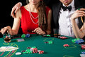 Casino gambling couple a rich elegant in a Royalty Free Stock Images