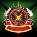 Casino gold-framed composition with roulette wheel Royalty Free Stock Images
