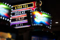 Casino jackpot sign with numbers on focus at background and defocused lights at foreground Stock Photo