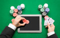 Casino poker player with cards, tablet and chips Royalty Free Stock Photo