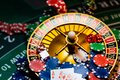 Casino set with Roulette, cards, dice and chips Royalty Free Stock Photo