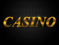Casino word spelled in shiny gold metallic letters on a black background Royalty Free Stock Image