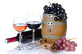 Cask bottle and glasses of wine with red and black grapes isolated on white Royalty Free Stock Photography